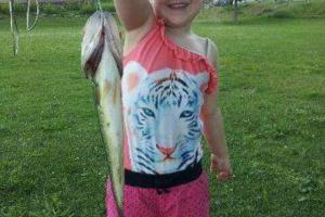 Hannah's First Catch. She's holding a bass