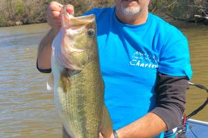 Angler holding  a 9 lb Largemouth Bass